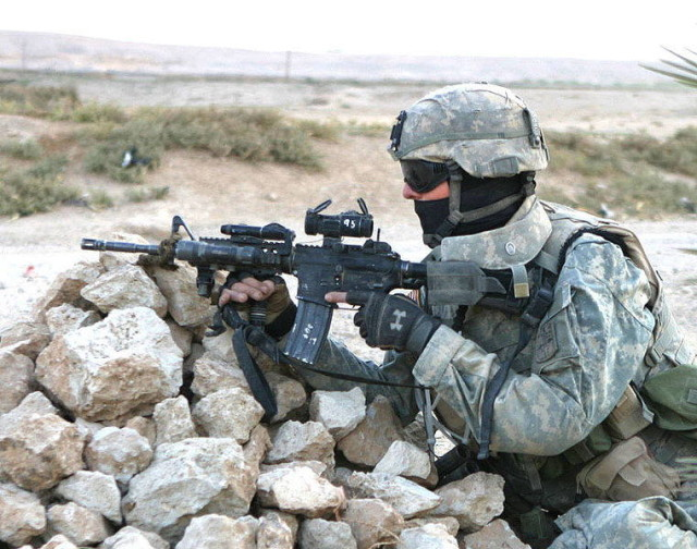 760px-US-Army_soldier_taking_cover