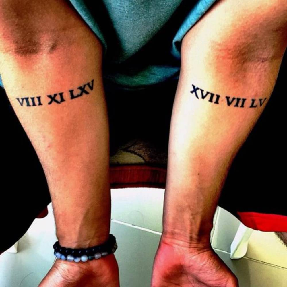 Forearm Tattoos Of The Birth Dates Of Merts Mother And