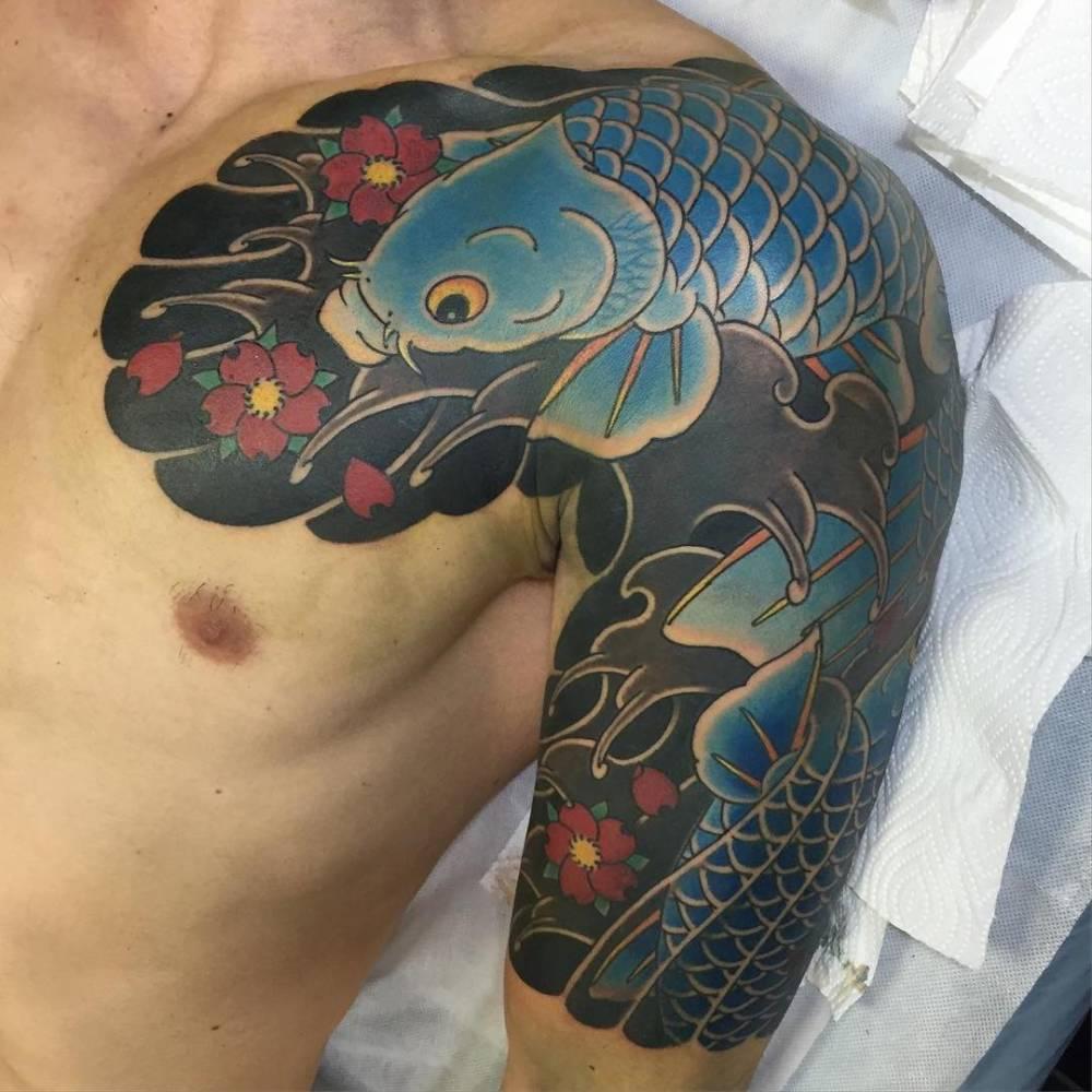 Koi Fish Tattoo Chest And Arm
