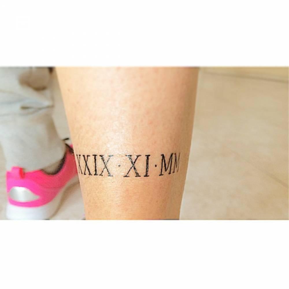 Calf Tattoo Of A Date In Roman Numerals On Patri