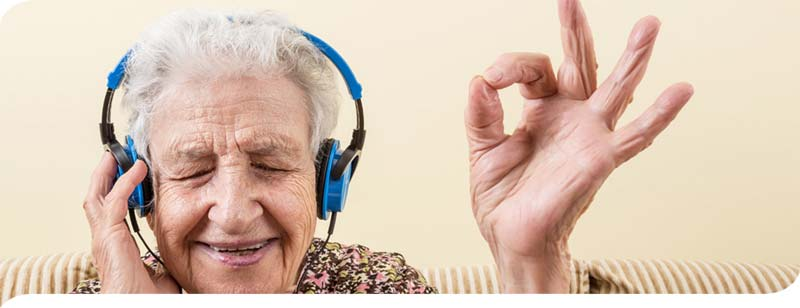 Grandmother feeling youthful listening to music