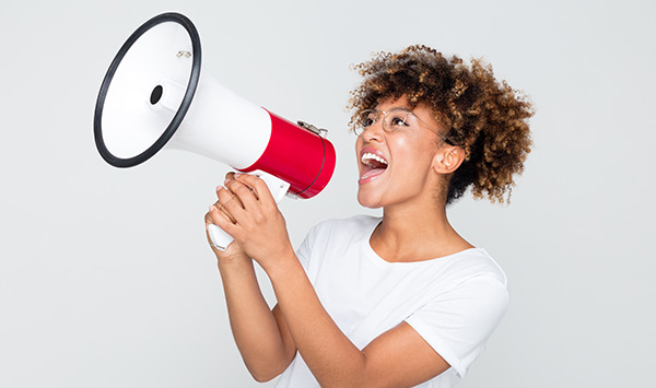 Women shouting with a megaphone