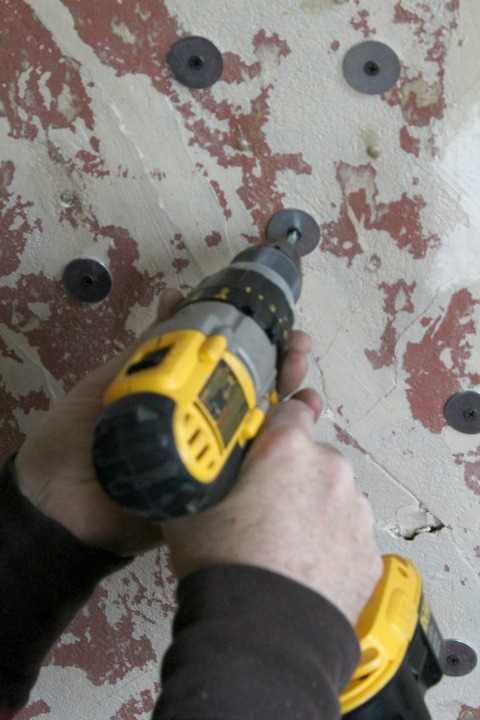 Drilling wall to repair plaster