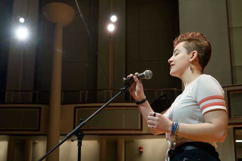 """Sydney Cargill sings an a capella version of Adele's """"Skyfall"""" on stage at the Gore Recital Hall."""