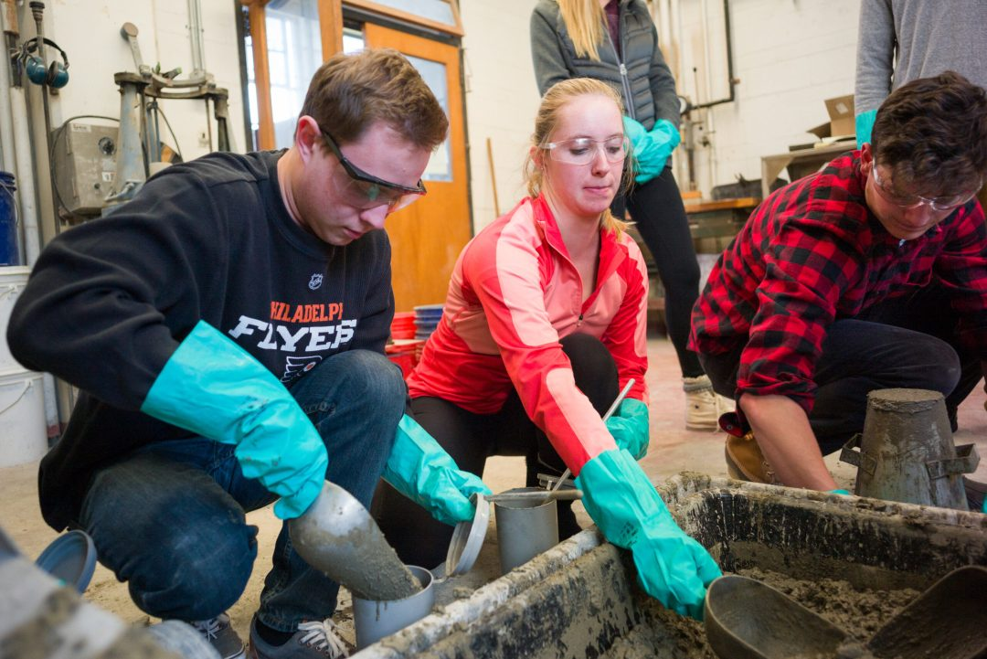 Students working in cement lab