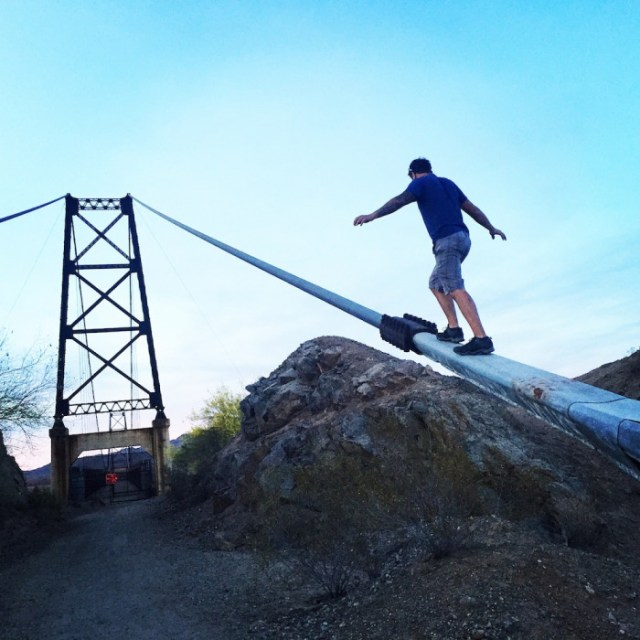 Josh Bolinger clibming a bridge in texas