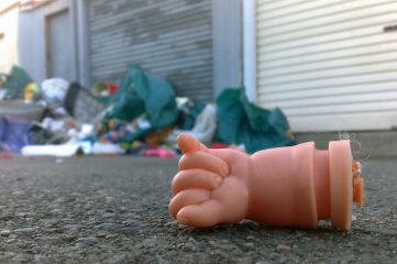 photo of a baby doll's fist