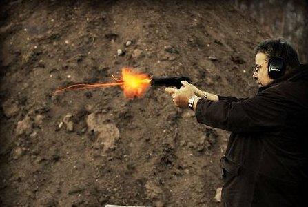 photo of a man firing a gun