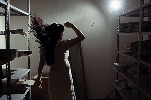 photo of woman in storeroom