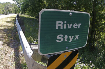 """photo of sign that says """"River Styx"""""""