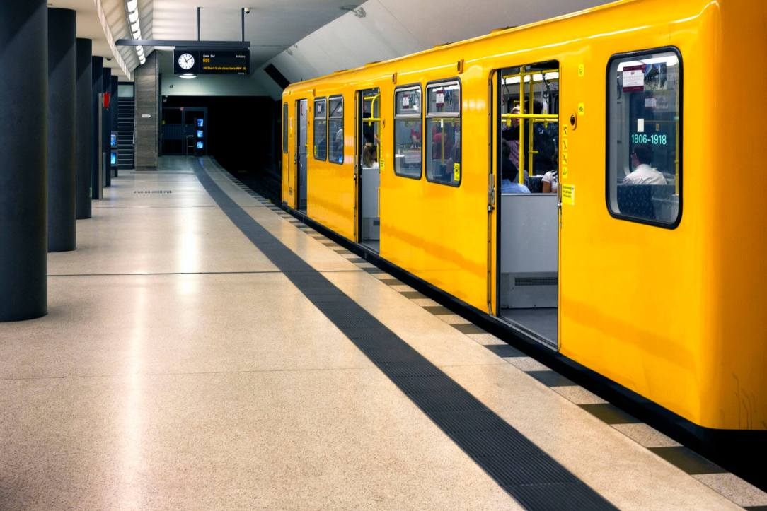 photo of yellow subway car in station