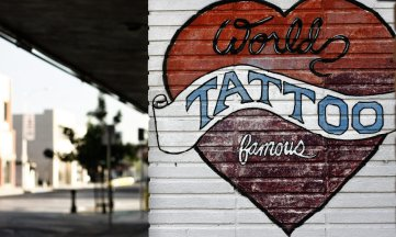 exterior wall of tattoo parlor with depiction of a heart tattoo