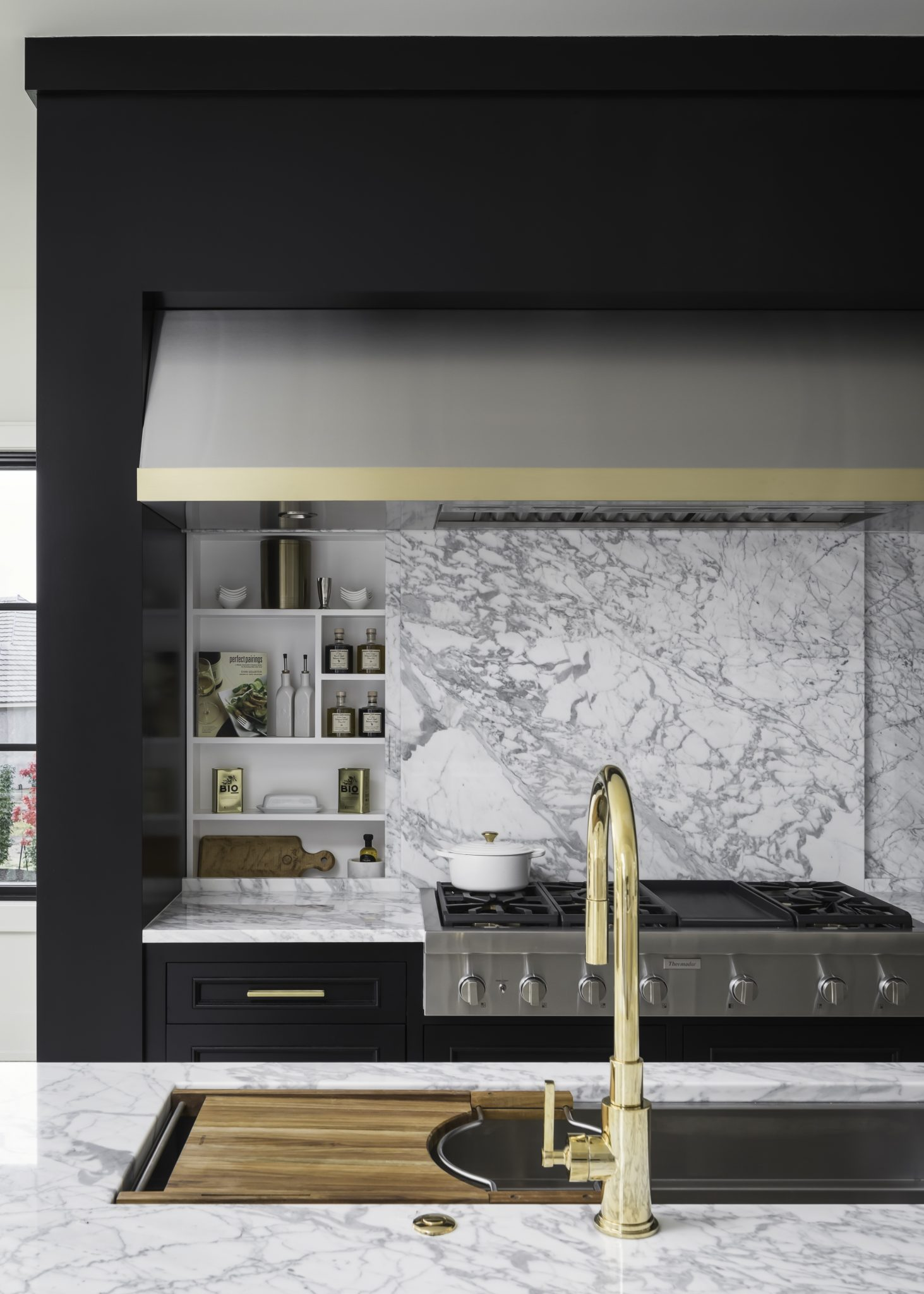 Modern stove hood with black cabinetry