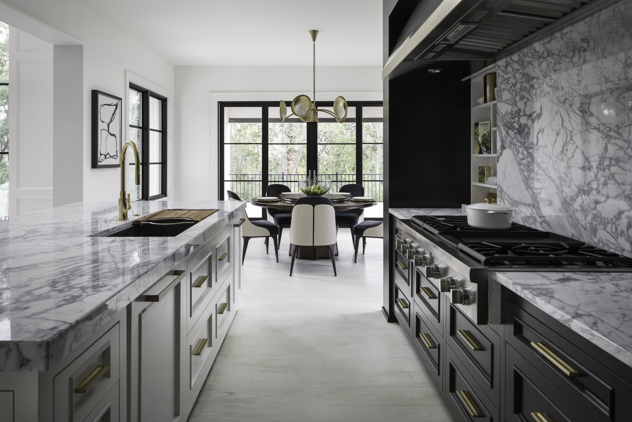 Kitch with black cabinetry and white countertop and walls
