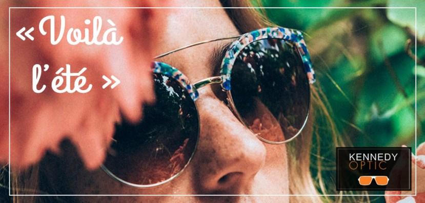 slide1-voilà l'été- gros plan sur les lunettes de soleil colorées d'une jeune femme