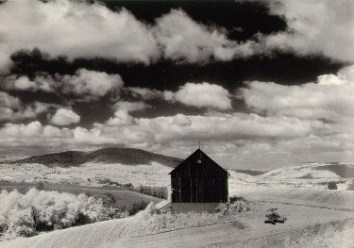 white_barn_and_clouds