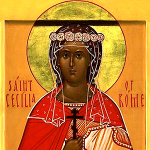 An Orthodox icon of a brown woman in a red cape, holding a cross. Text: Saint Cecilia of Rome.