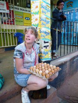 Volunteer in Uganda Orphanage going to market for eggs.