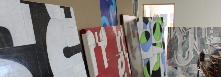 Preparing Paintings for shipping in Cecil Touchon's Painting Studio