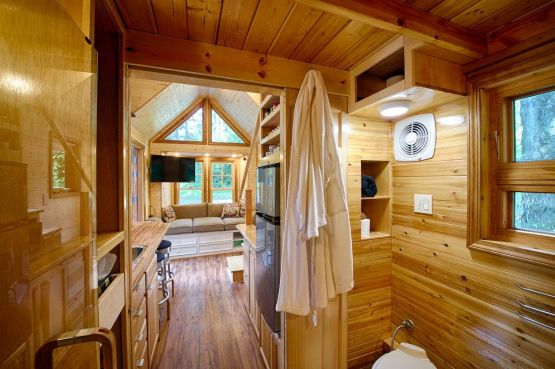 Wood paneling is an ideal choice for tiny home interiors due to its light weight and workability