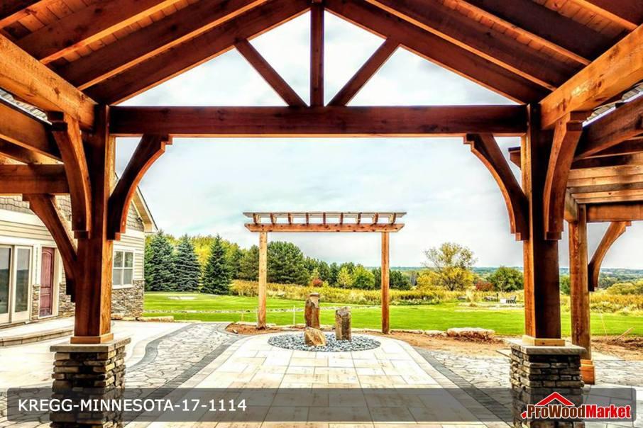 Custom built Western Red Cedar entry way with massive cedar posts and stone work