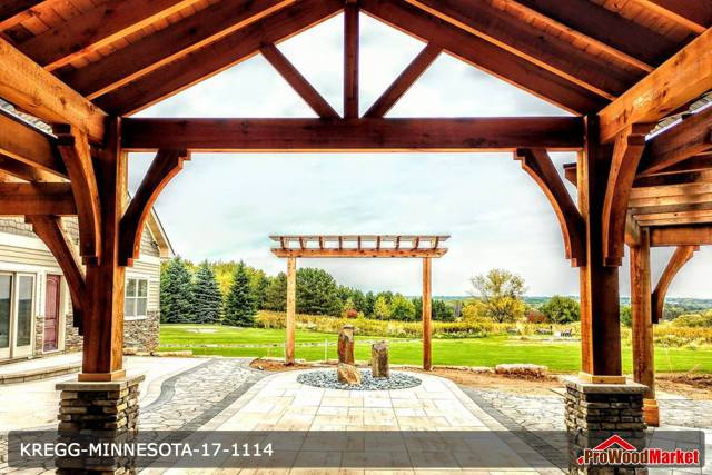 Custom built Western Red Cedar entry way with massive cedar posts and stone work