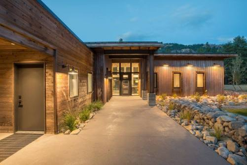 Knotty Western Red Cedar and Metal Siding protect this home against wildfires