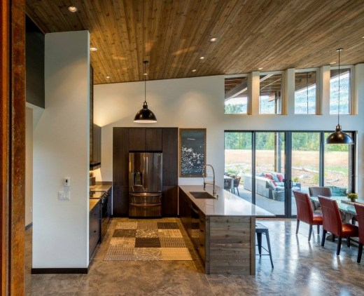 crisp white walls and knotty Western Red Cedar ceilings define this modern, rustic home