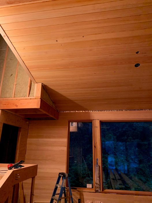 douglas fir interior paneling is perfect for this cabin in the woods