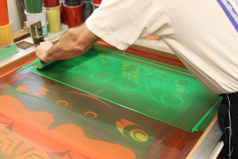 Spreading ink over a silkscreen