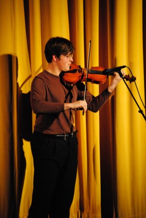 Noah Flanders wins the audience with a fiddle performance. (Photo: Kari Barnhill)