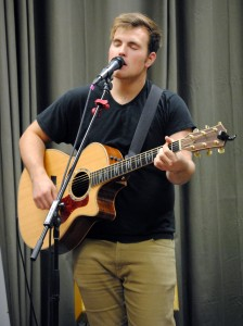 Isaac Murrell, a senior  singer and guitarist, plays with the Heartsong Green team. (Photo: Kari Barnhill)