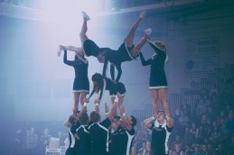 Cheerleaders complete stunts during their routine at Moonlight Madness. (Photo: Jillian Philyaw)