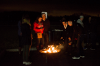 Fire pits help take the bite out of the chilly wind, while students take bites out of their s'mores during the ALT night.