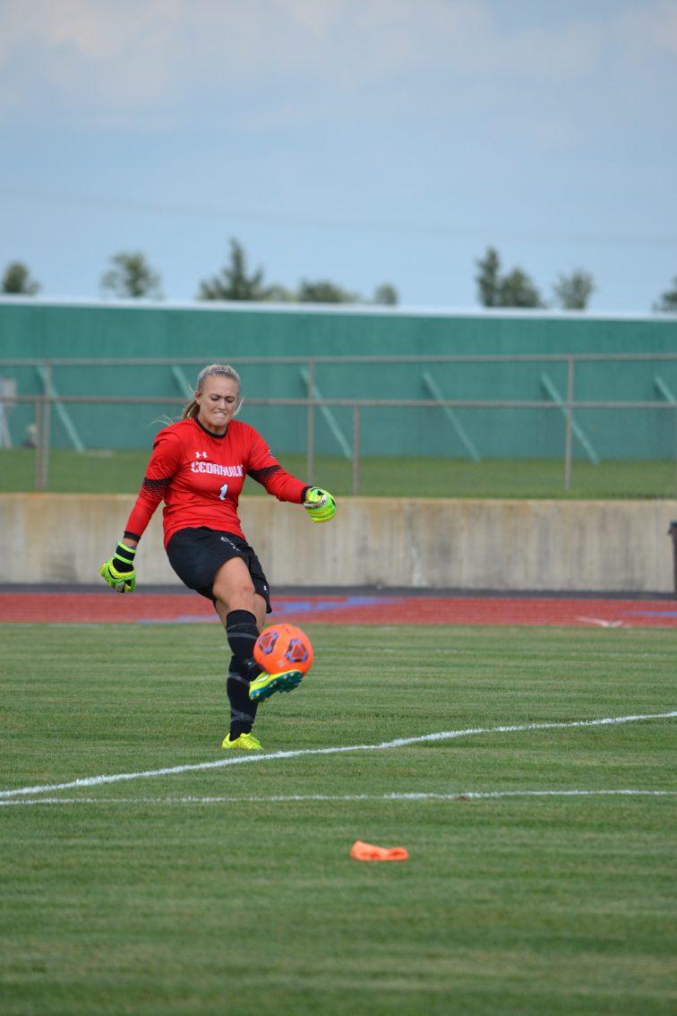 Senior goalkeeper Hanna Harris kicks the ball back to her teammates. (Photo: Andriana Polsdorfer)