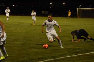 Bradley Schluter dribbles past a sliding Trevecca defender. (Photo: Campbell Bortel)