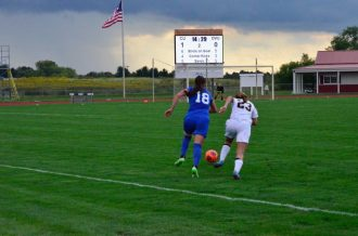 Hannah Whicker sprints upfield to steal the ball. (Photo: Allyson Weislogel)