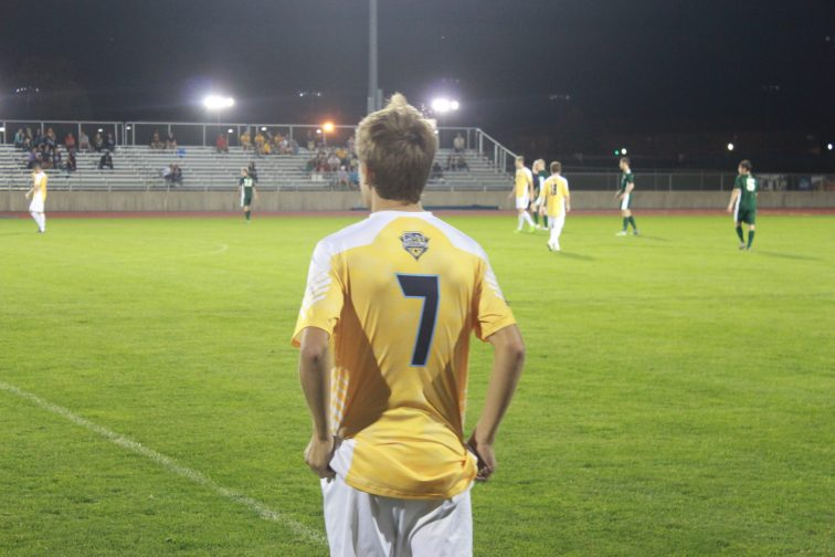 Derek Braak looks at the field from the sidelines. (Photo: Alex Weber)