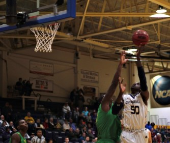 Robert Okoro finishes with a layup after being fouled (Photo: Christian Cortes).