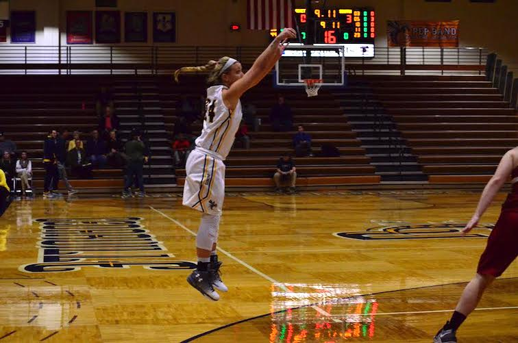 Kaitlyn Holm takes a 3-point shot (Photo: Allyson Weislogel).