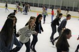 Many friends formed chains in order to keep their balance on the ice.