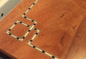 custom inlay on a desk built by Cedars Woodworking
