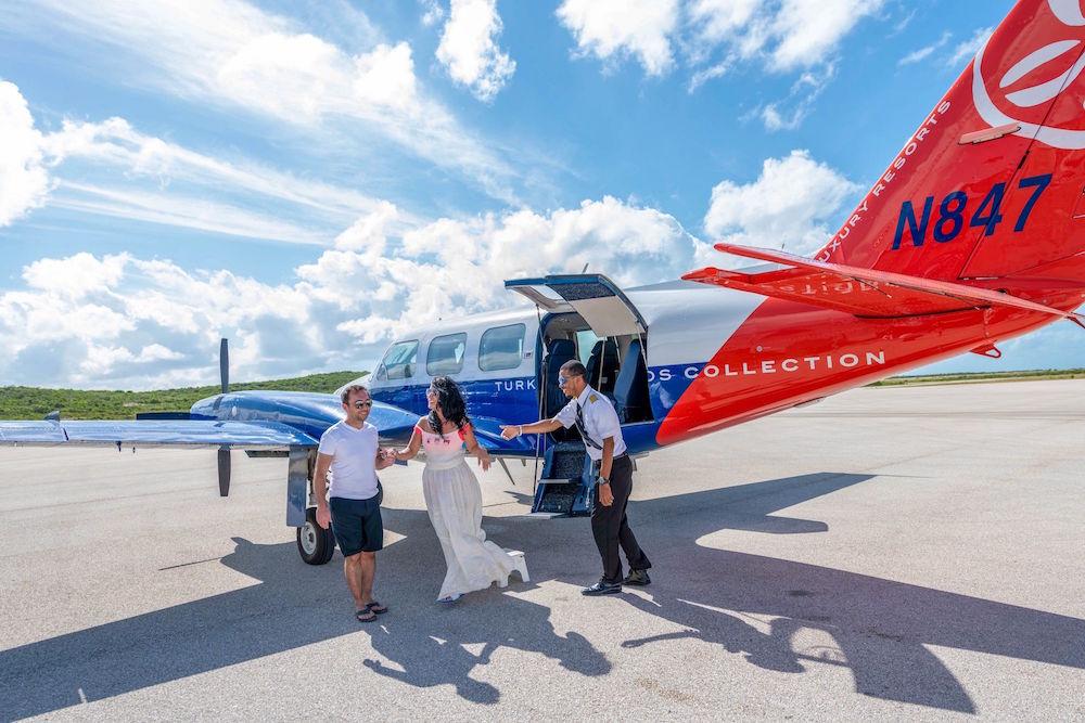 TCC-plane-arrival-Ambergris-Cay.jpeg