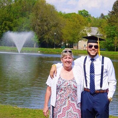 Proud mom, happy Huskie graduate: Tina and Jamaal Hines celebrate at NIU's East Lagoon.