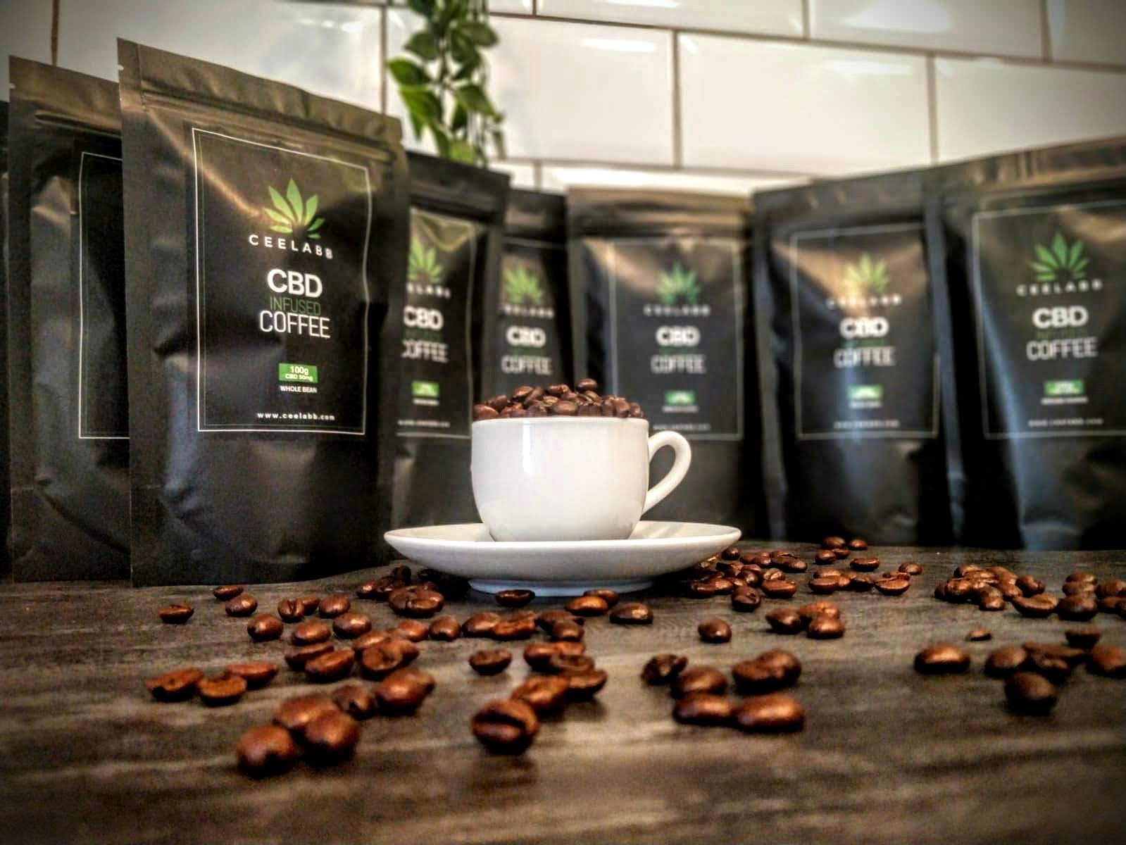 Ceelabb CBD infused Coffee beans in an espresso cup with Ceelabb 100gram bags of cbd coffee in the background