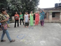 Young women factory workers participating in fertility dance