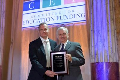 CEF Vice President Jeff Carter presents the Terrel H. Bell Award to Senator Jack Reed
