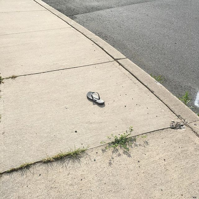 Random sandal on the sidewalk must have a great back-story.