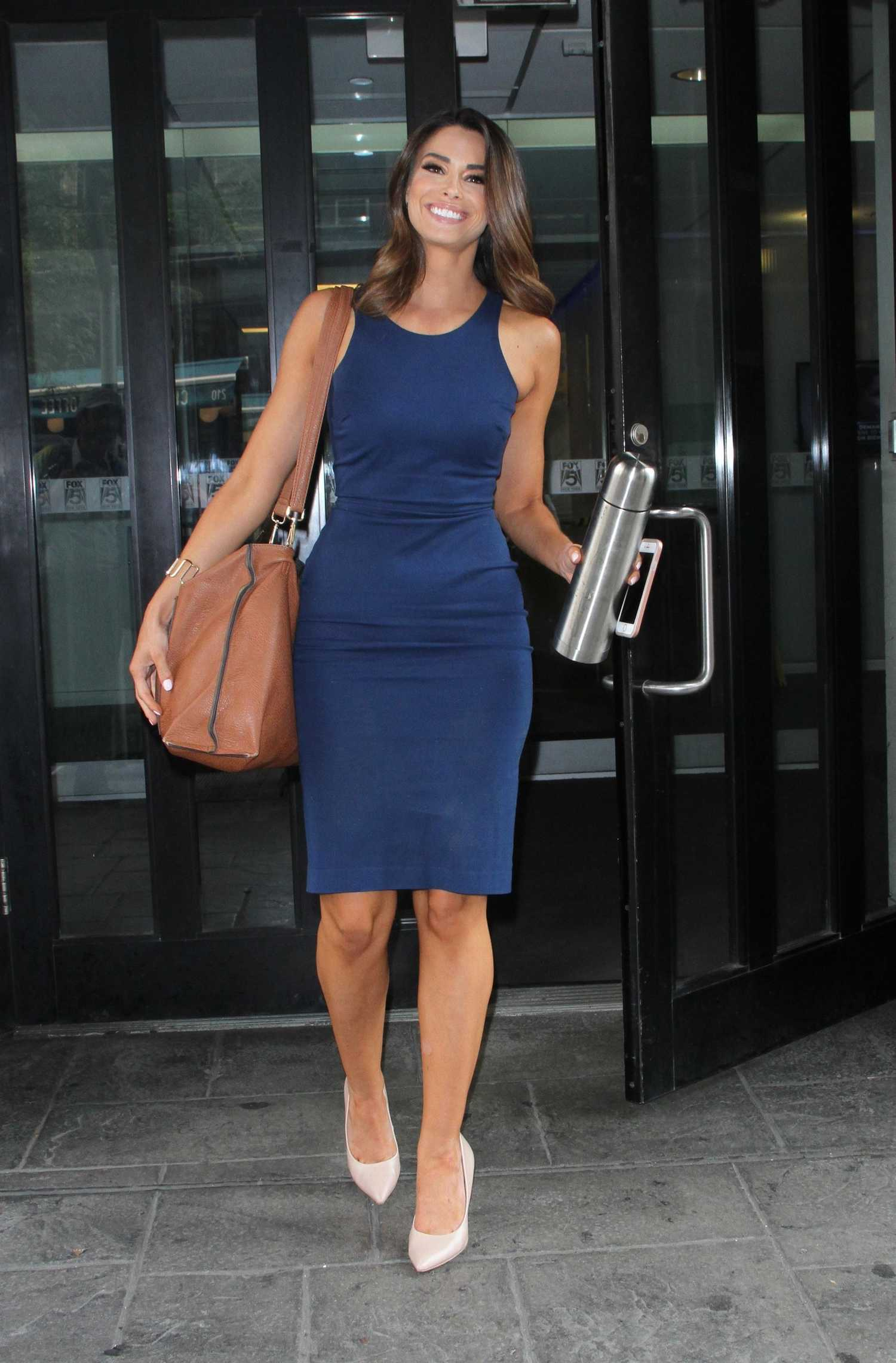 Jennifer Lahmers in a Blue Form Fitting Dress Was Seen Out