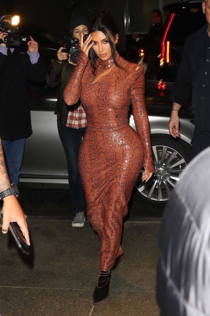 Kim Kardashian in a Brown Form Fitting Dress Leaves Dinner